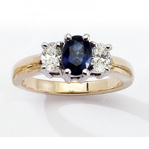 14K Yellow Gold Three Stone 7x5 Oval Sapphire and .50 Ct Diamond Ring