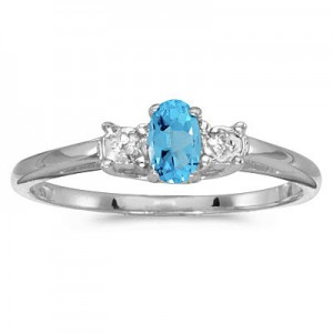 14K White Gold Oval Blue Topaz and diamond accent birthstone ring