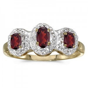 10k Yellow Gold Oval Garnet And Diamond Three Stone Ring