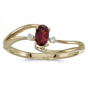 10k Yellow Gold Oval Garnet And Diamond Wave Ring